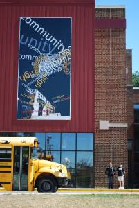 One of two banners recently hung on the back of Community High School, facing the Kerrytown district.