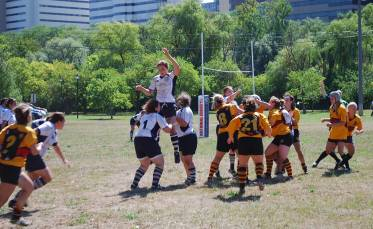 Players on the Ann Arbor Women's Rugby Football Club (in white jerseys) battle Detroit for the ball during Saturday's game.