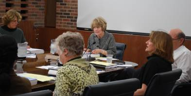 UM President Mary Sue Coleman, at the head of the table, talks to regents at their Thursday board meeting.