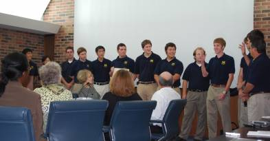 Members of UM's Solar Car Team answer questions at the Board of Regents meeting. The team won ...