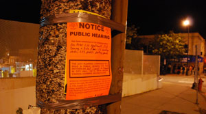 Notice of public hearing on Oct. 7 held by the planning commission. In the background, fans of State Radio with Bongo Love in line at the Blind Pig