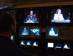 Greg McDonald, director for the debates, keeps an eye on the camera shots from the control room.