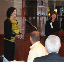 Susan Pollay, right, introduces Amanda Uhle of 826michigan at Wednesday's Morning Edition breakfast.