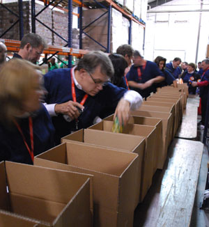 The Frito-Lay Blue Team loads boxes of food in the Food Gatherers warehouse.