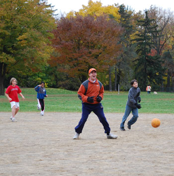 Bob Schoeni gets put out in a game of kickball trying to stretch a single into a double.