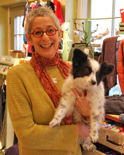 Vicki Honeyman and her Papillon, Lucy, in her Ann Street shop, Heavenly Metal.
