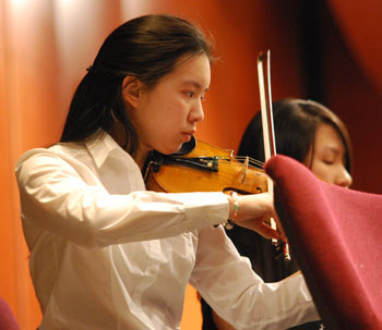 Emily Hsiao plays violin for the symphony orchestra.