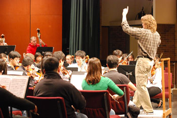 Chris Mark conducts a rehearsal Monday afternoon of the Huron High symphony orchestra.
