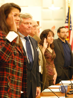 The swearing-in ceremony: Commissioners Jessica Ping, Mark Ouimet, Wesley Prater, Kristin Judge and Conan Smith.