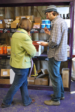 Brad Hedeman talks with a customer at the Zingermans Mail Order temporary retail store.