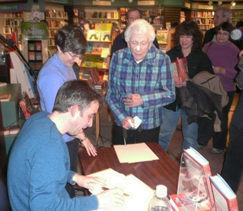 Steve Amick signs copies of his book at a Marach 10 reading at Nicolas Books.