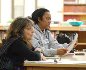 School board member Susan Baskett, left, attended Tuesdays budget forum at Scarlett Middle School.