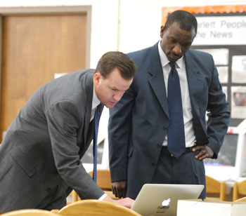 Todd Roberts, superintendent of Ann Arbor Public Schools, and Robert Allen, deputy superintendent for operations, look over their presentation before Tuesdays budget forum at Scarlett Middle School.