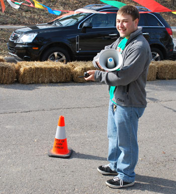 Ben Kaufman wields walkie-talkie and megaphone to manage the bottom of the hill.