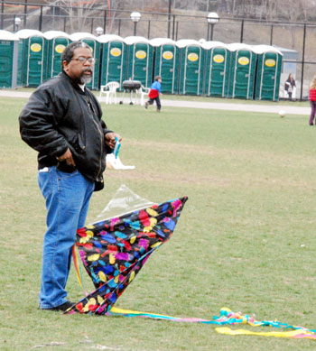 Guy standing with a kite in Palmer Field