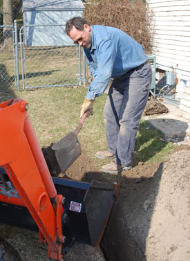 Richard Connors digs part of this outside ditch by hand.