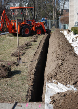 This dig runs from along the side of the house, taking water along a pipe from the basement to a connection with the stormwater system,near the sidewalk.