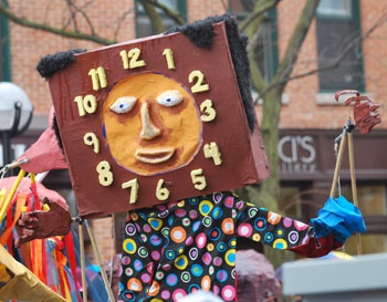 FestiFools puppet that looks like a clock