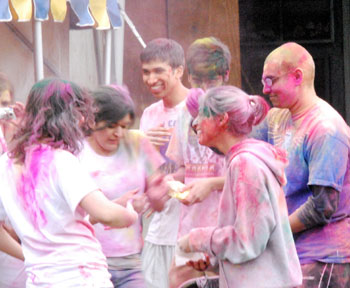 UM students throwing Holi Powder on each other
