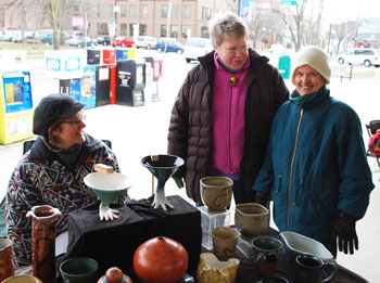 The three Js, from left: Jane Kent, Jane Holt and Joan Hutchinson, at Kent's pottery booth. All three are officers on the artisan market board.