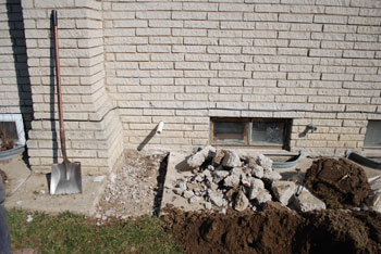 The pipe protruding from the basement wall will eventually be hooked into a pipe thats laid in a ditch next to the house, connecting it to the stormwater system.