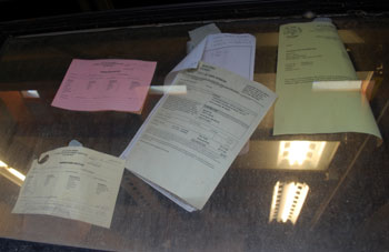 permits for construction taped to glass