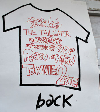 Outline of a T-shirt that lists sandwich names