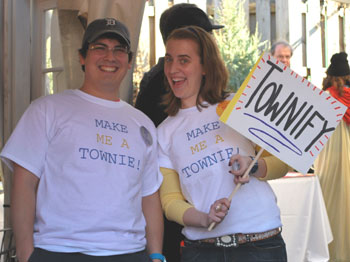 Two people in T-shirts that say make me a townie