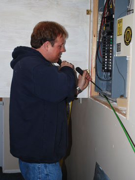 Rob Vetter installs a new electrical circuit for the sump pump.