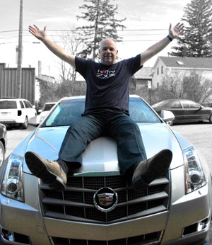 Ernie Perich and his Cadillac CTS.