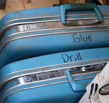 blue suitcases labeled glue and drill