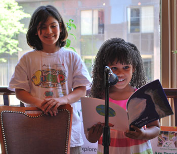 Maria LoCicero and Leandra Blander read from the book Moon Wolf, which they helped illustrate.