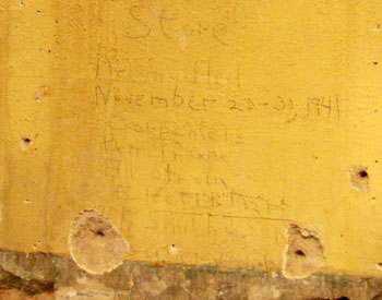 A close-up of a section of plaster at SPARK East, which was signed in 1941 by workers remodeling the space. The section was uncovered during a more recent remodel this year.