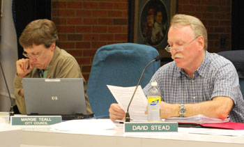 David Stead, right, reads a resolution he proposed at Thursday nights Environmental Commission. The resolution, which was approved, recommends removing Argo Dam.