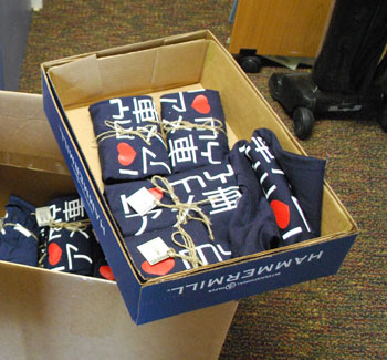 T-shirts wrapped, labeled and ready to ship at Perich Advertising + Design in Ann Arbor.