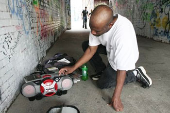 Brian Woolridge with his boom box and Michael Jackson CDs in the alley next to the Michigan Theater.