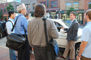 Members of the Ann Arbor Energy Commission look at a hybrid plug-in Ford Escape after their Tuesday evening meeting.