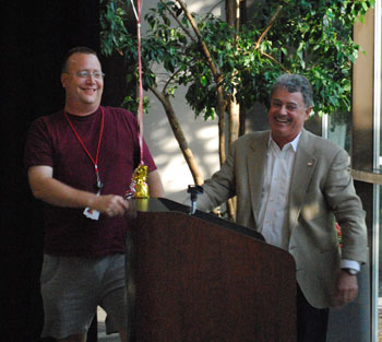 Red Cross volunteer Steve Luedders, left, shakes hands with Bill McGill after receiving the Dan Kivel Blackbird award at Wednesday evenings awards ceremony
