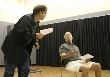 David Babcock and Ed Koster act out a scene from Hellcab at the Ann Arbor Civic Theatre auditions.