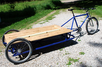 Tricycle with platform for carrying heavy loads like a piano