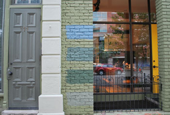 Four swatches of paint on the building at 113 S. Fourth Ave. in Ann Arbor.