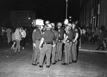June 17, 1969: Officers confer as the crowd swarms on to South University. (Photo courtesy of Jay Cassidy.)