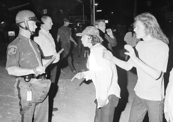 June 17, 1969: Youths confront officer on South University. (Photo courtesy of Jay .)