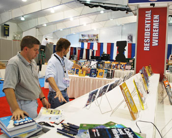 Marty Riesberg, left, NJATC director of curriculum confers with assistant director of curriculum Jim Simpson as they put out books for display.