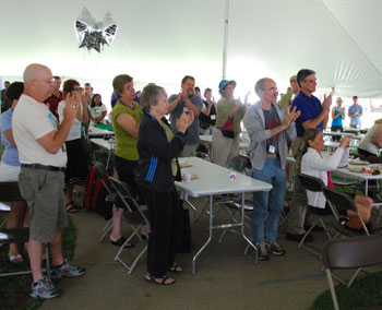 Artists, board members and staff of the Street Art Fair give Shary Brown a standing ovation at the end of Thursdays awards breakfast.
