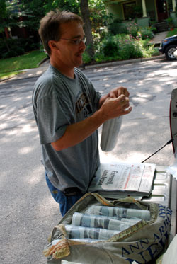 last day of the Ann Arbor News a guy rolling papers