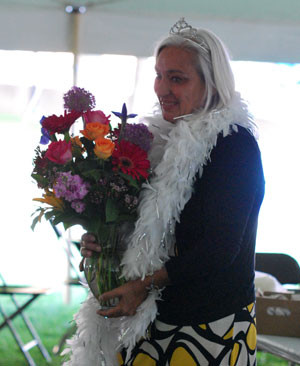 Shary Brown, with gifts from her staff and artists of the Street Art Fair, at an awards breakfast on Thursday.