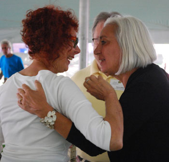 Shary Brown, right, congratulates artist Shelly Bender, who received an award at Thursdays breakfast.