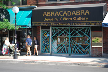 Abracadabra is located across from the federal building and post office, between Chelsea Flower and Sams