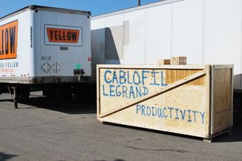 This crate had been delivered to the loading dock of the Indoor Track Building. No, we don't know what it means. (Photo by the writer.)